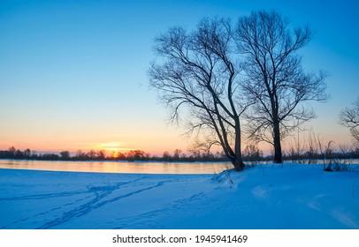 Winter nature river dawn landscape. Sunrise winter snow dawn - Shutterstock ID 1945941469