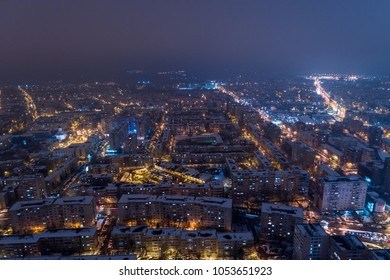 Winter night aerial view from Timisoara taken by a professional drone in the snow. City lights seen from above