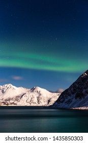 Winter night with aurora in a mountains