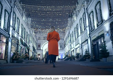 winter night in the city lights / adult girl in a coat walk in the city, fashionable stylish image of a beautiful model
