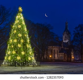 Winter night and decorative Christmas tree in old city park of Jurmala, Latvia, EC