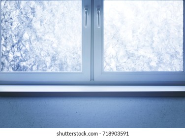 Winter night, frozen window with snow and ice under moon light