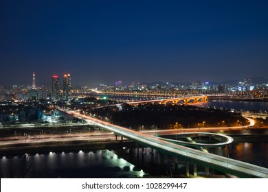 Winter night landscape with a highway, Sung-su bridge and Lotte World Tower in Seoul, Korea.