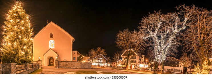 Winter night lights in an Austrian village Night photography in the Ehrwald village, from Austria, during winter season, when all the buildings and trees are decorated with lights.