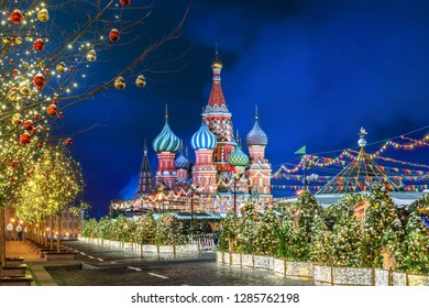 Winter night on the Red Square in Moscow and St. Basil's Cathedral and Christmas decorations on fir trees and trees