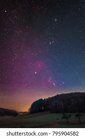 Winter night sky including Barnard's Loop, the Orion Nebula, the Flame Nebula, the Rosette Nebula, the California Nebula, and the Pleiades as seen from Lampenhain in Germany.