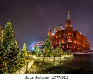 Winter night view of the big Christmas tree and decoration on the Manezhnaya square with the State historical Museum in Moscow, Russia.