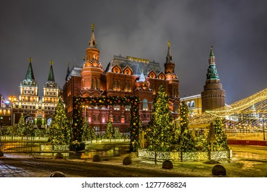 Winter night view of the State historical Museum, Iverskaya chapel and Uglovaya Arsenal'naya tower of Kremlin with the Christmas decoration on the Manezhnaya square in Moscow, Russia.