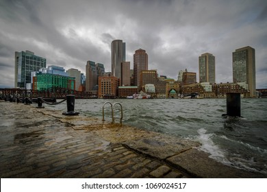 A winter Nor'easter storm surge floods Boston Harbor.