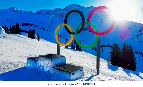 Winter Olympic Games - The Olympic rings and the stage for winners on the top of snowy Blackcomb mountain in Whistler, BC on January 9, 2018