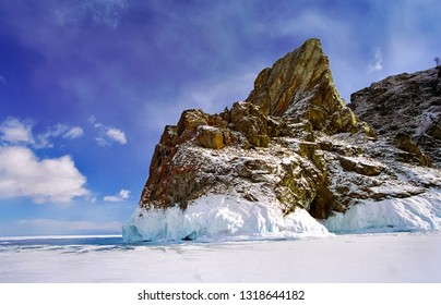 Winter on the Baikal, ice and snow on the lake. The beauty of the nature of Baikal in winter.