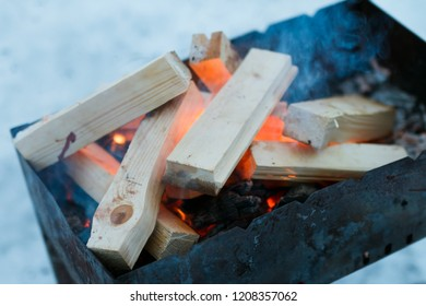 in the winter on a brazier firewood