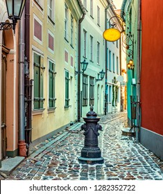 Winter on narrow street in old Riga - the capital of Latvia and famous Baltic city with unique medieval and Gothic architecture