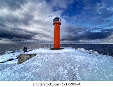 Winter on shore of the Baltic Sea. Lighthouse in ice - Shutterstock ID 1917539474