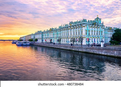 Winter Palace building housing Hermitage museum reflects in Neva river on dramatic sunrise, St Petersburg, Russia