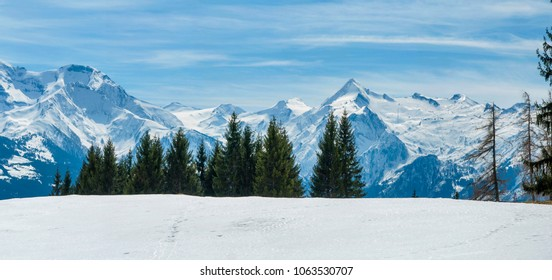 Winter Panorama of Alps. W inter panorama with meadows covered by snow and with mountains in behind.