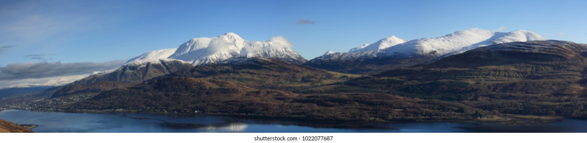 Winter panorama of Ben Nevis, Aonach Mor, Aonach Beag, the Mamores and the Grey Corries in Lochaber in the Scottish Highlands.