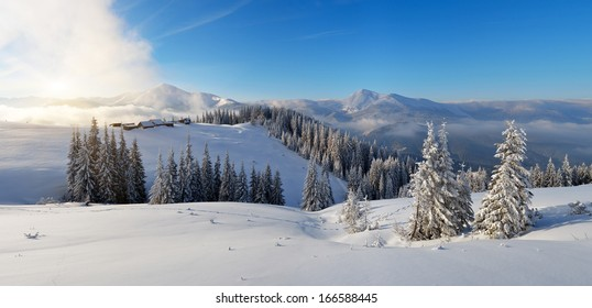 Winter panorama of mountain scenery in the morning. First sunlight. Carpathians, Ukraine, Europe