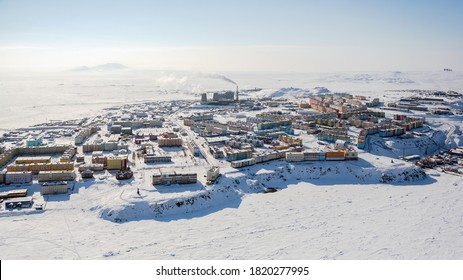 Winter panorama of the northern city of Anadyr. Aerial view of a snow-covered arctic town in the Russian Far North. Anadyr is the administrative center of the Chukotka Autonomous Region of Russia.