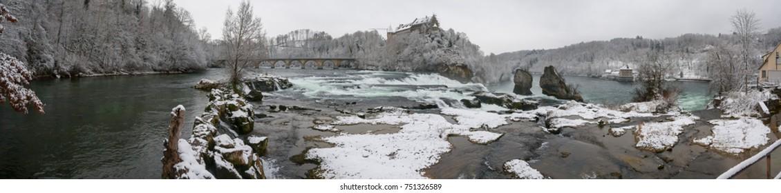 Winter panorama of Rheinfall with bridge over Rhine River. Neuhausen am Rheinfall, Schaffhausen, Switzerland.