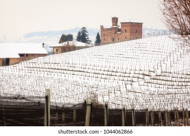 Winter panoramic view of the hilly region of Langhe (in the southern area of Piemonte Region, Northern Italy), with the Grinzane Cavour 800's castle (Cuneo Province).