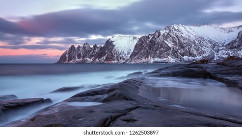 Winter panoramic view to Steinfjord on Senja island in the sunset - Troms county, Norway (long exposure)