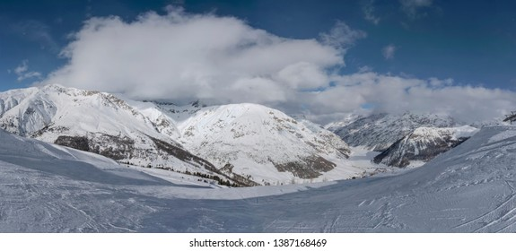 Winter panoramic view from the top on Livigno city and lake Livigno. Italy.