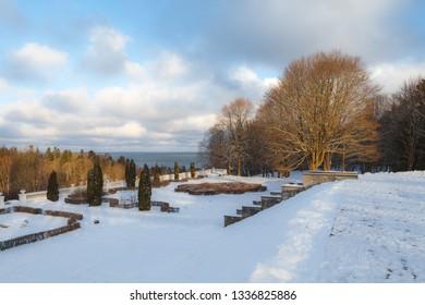 Winter park alleys. Toila park in Estonia. Sunny winter day, tranquil beautiful landscape.