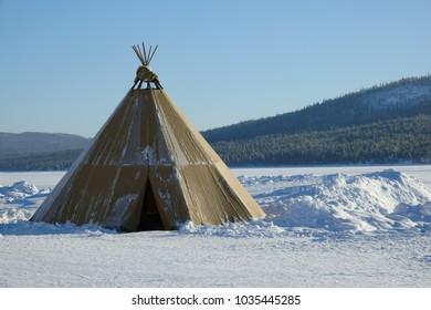 Winter polar landscape with eskimo tent in the Sweden.