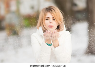 Winter portrain of beautiful blonde girl in snow