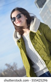 Winter portrait of a beautiful girl
