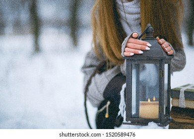 Winter portrait of a beautiful girl in a snowy forest, wrapped in a blanket. snowflakes on her hair, cold, beautiful woman is warming, the atmosphere of winter, it is snowing, the girl is warming he
