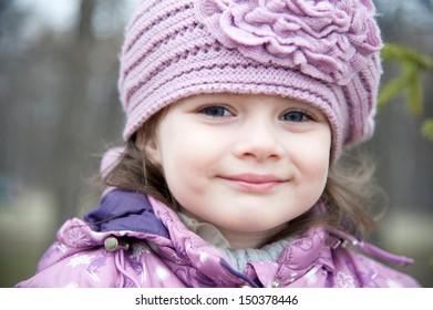 Winter portrait of a beautiful little girl