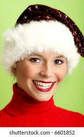 winter portrait of a beautiful young smiling woman with a christmas cap
