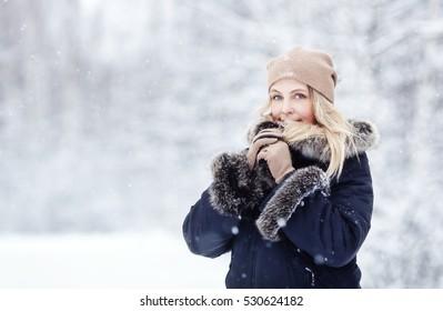 Winter portrait of blonde woman