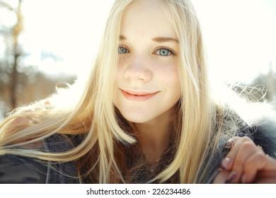 7b0e9d5f25 winter portrait of a cute blonde teen
