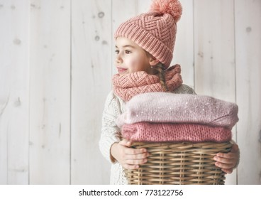 d53a2bd651e Winter portrait of happy little girl wearing knitted hat