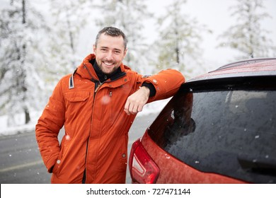 Winter portrait of a man. The man is traveling on the road