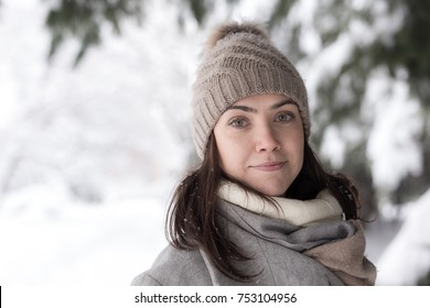 Winter portrait of pretty young female with hat