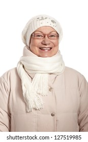 Winter portrait of smiling elderly lady, wearing warm coat, cap and scarf.