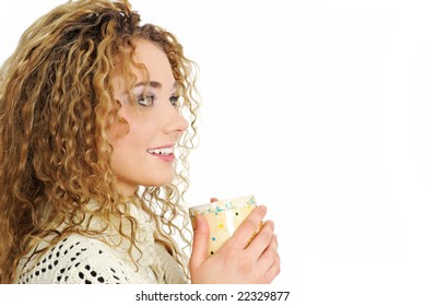 winter portrait of a smiling woman with a cup of hot tea