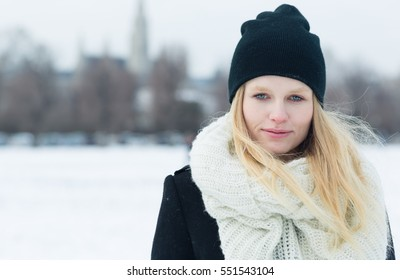 Winter portrait of young beautiful blonde woman outdoors.