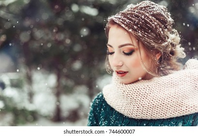 Winter portrait of a young fashionable beautiful girl with long blondie hair have a good time outdoor in a snowy forest. Stylish young bride on winter wedding. Nature, winter. leisure, beauty concept