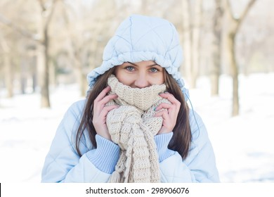 Winter Portrait of Young Woman wearing clothing for cold weather at snow day. Happy Caucasian female wintertime season outdoor.
