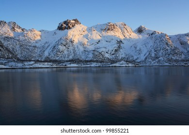Winter in Raftsund between the Norwegian archipelagos of Lofoten and Vesteralen. View from a cruise ship between Stokmarknes and Svolvaer in the Raftsund at sunset.