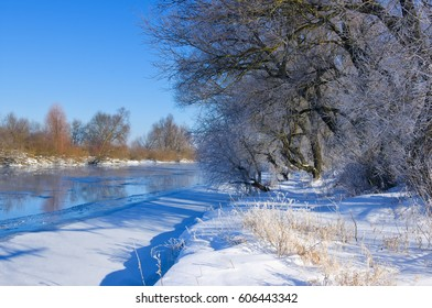Winter river and blue sky