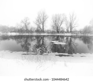 winter river during a heavy snowfall