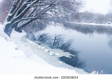 Winter river during a snowfall