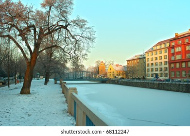 winter river in historic town