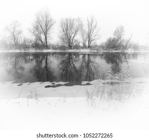 winter river. Winter landscape with a quiet river and falling snow.